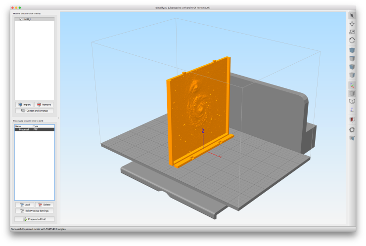 """A screen shot of Simplify3D showing a galaxy model that is oriented """"edge on"""" on the print bed."""