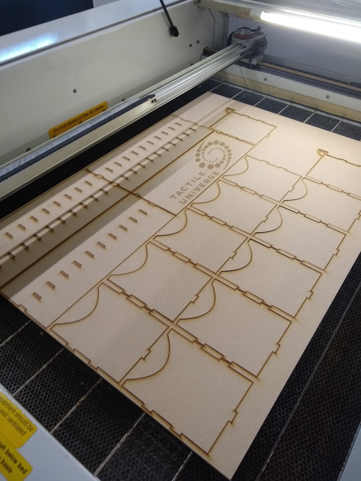 The box pieces after the laser cutter is done cutting them out